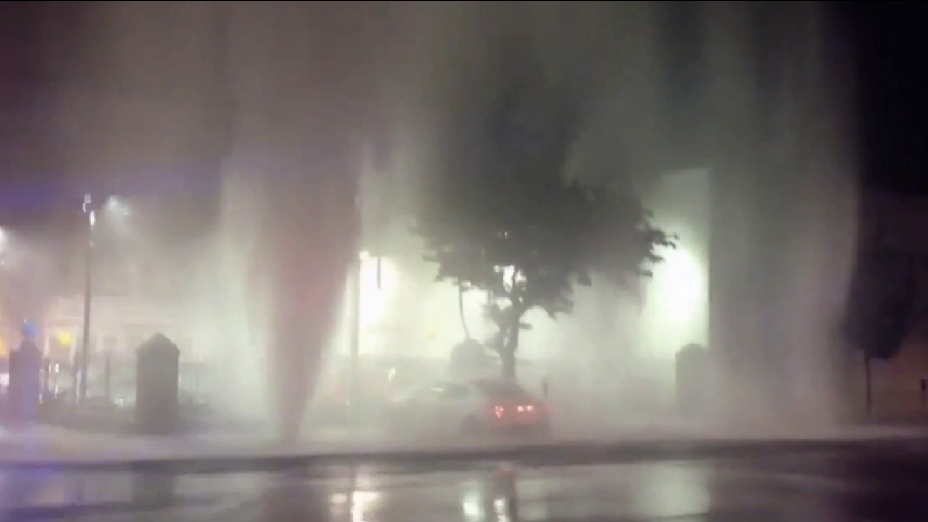 Water shoots into the air after a car crashes into a fire hydrant in Hollywood on Thursday, March 12, 2015.