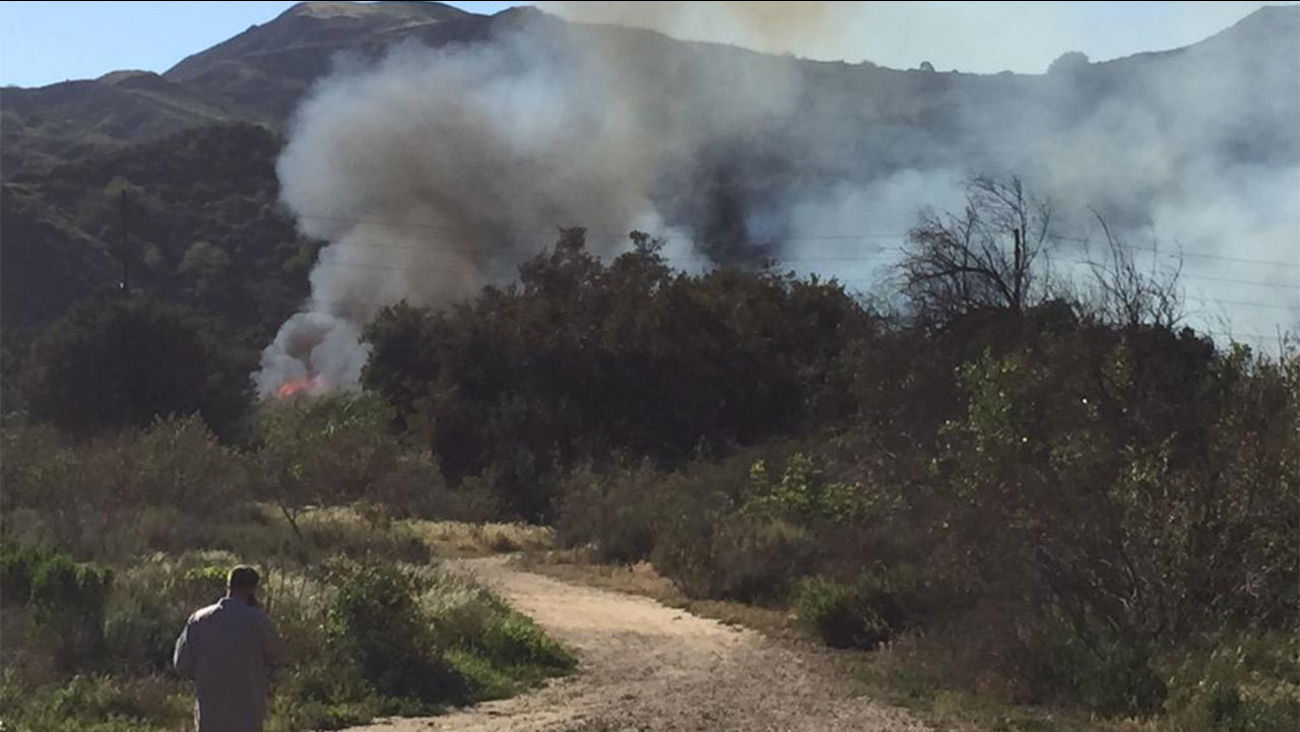 A brush fire broke out in the riverbed near the 5300 block of North Ventura Avenue in Ventura Thursday, March 12, 2015.
