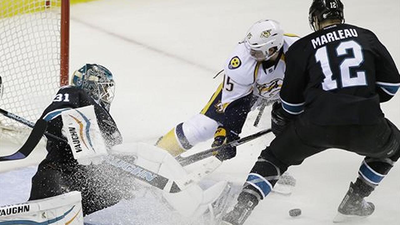 San Jose Sharks goalie Antti Niemi deflects a shot by Nashville Predators