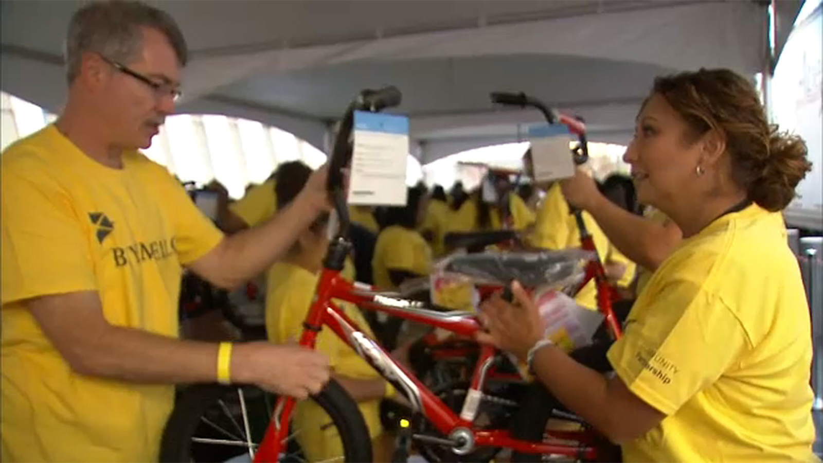 Be Kind: Hundreds of volunteers come together for 9/11 Tribute Museum's annual Bike Build