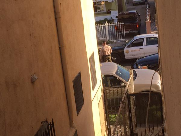 """<div class=""""meta image-caption""""><div class=""""origin-logo origin-image none""""><span>none</span></div><span class=""""caption-text"""">ABC7 viewer Lilly snapped this picture of her view of a standoff with a suspect in South L.A. on Friday, March 13, 2015.</span></div>"""