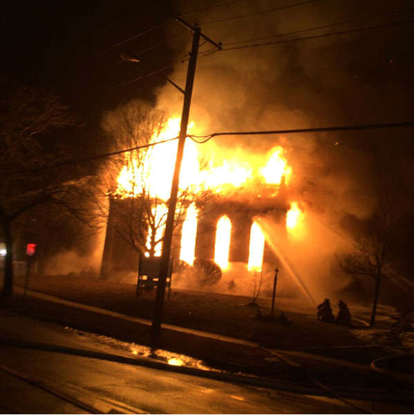 "<div class=""meta image-caption""><div class=""origin-logo origin-image none""><span>none</span></div><span class=""caption-text"">A fire early Sunday morning swept through the First Universilist Church on Route 25 in Southold.</span></div>"