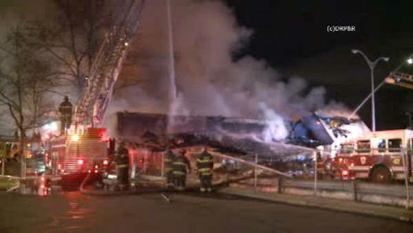 """<div class=""""meta image-caption""""><div class=""""origin-logo origin-image none""""><span>none</span></div><span class=""""caption-text"""">A three-alarm fire that broke out Sunday night engulfed a convenience store in Irvington, New Jersey.</span></div>"""