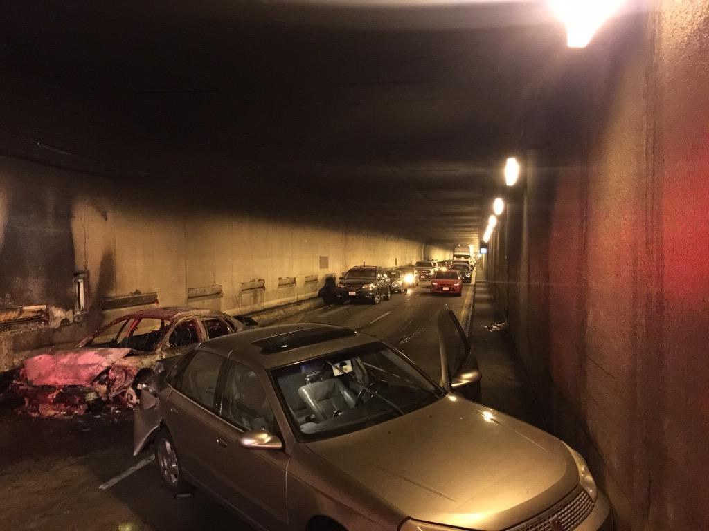 """<div class=""""meta image-caption""""><div class=""""origin-logo origin-image none""""><span>none</span></div><span class=""""caption-text"""">A car caught fire on the eastbound bore of the Caldecott Tunnel Monday morning, Mar. 16, 2015.  Dozens of people fled from their vehicles on foot. ((Twitter/@Oaklandfirelive))</span></div>"""