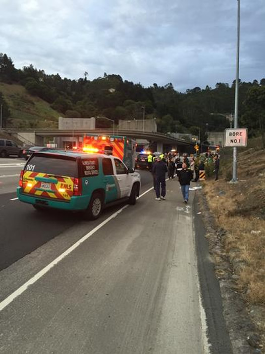 """<div class=""""meta image-caption""""><div class=""""origin-logo origin-image none""""><span>none</span></div><span class=""""caption-text"""">People stranded on Hwy 24 after a car caught fire on the eastbound bore of the Caldecott Tunnel Monday morning, Mar. 16, 2015.  Dozens of people fled from their vehicles on foot. ((KGO-TV/Amy Hollyfield))</span></div>"""
