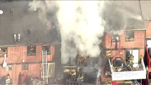 "<div class=""meta image-caption""><div class=""origin-logo origin-image none""><span>none</span></div><span class=""caption-text"">A fire broke out inside a townhouse in the Rossville section of Staten Island on Monday afternoon. (WABC Photo/ WABC)</span></div>"