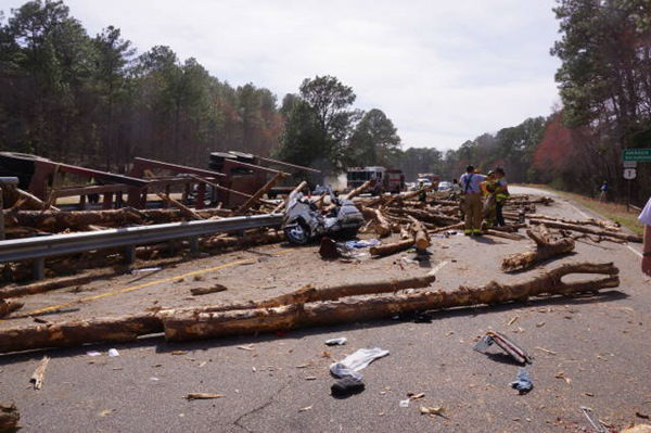 """<div class=""""meta image-caption""""><div class=""""origin-logo origin-image none""""><span>none</span></div><span class=""""caption-text"""">Investigators say the truck's load shifted, causing it to flip</span></div>"""