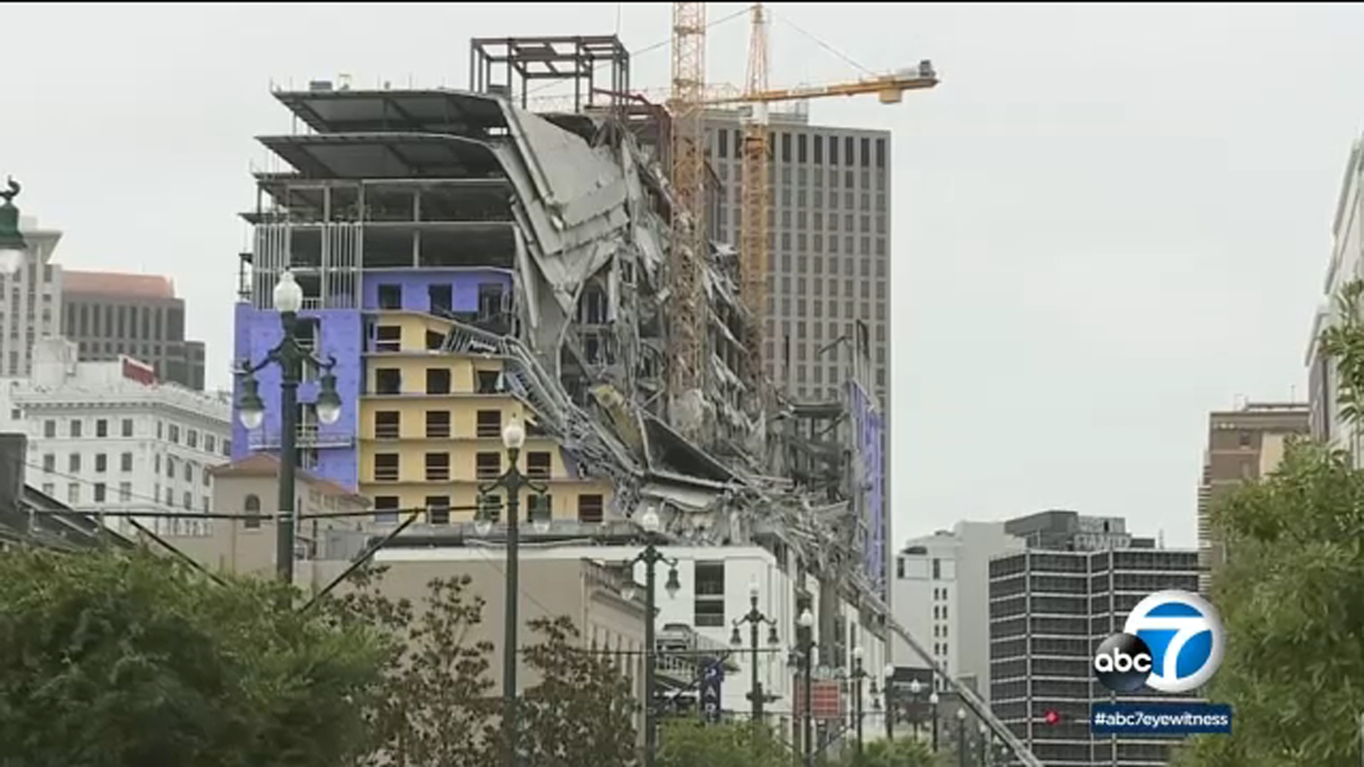 The collapse at the hotel under construction sent workers running on popular Canal Street. At least 1 person died.