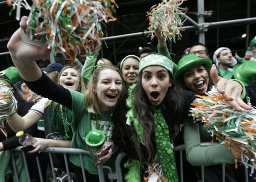 <div class='meta'><div class='origin-logo' data-origin='none'></div><span class='caption-text' data-credit='AP Photo/ Mary Altaffer'>People cheer as participants march up Fifth Ave. during the St. Patrick's Day Parade, Tuesday, March 17, 2015, in New York.  (AP Photo/Mary Altaffer)</span></div>