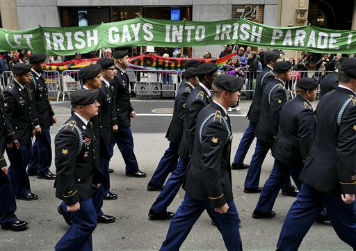 <div class='meta'><div class='origin-logo' data-origin='none'></div><span class='caption-text' data-credit='AP Photo/ Seth Wenig'>Marchers walk past a group of protesters during the St. Patrick's Day Parade  The group was protesting the exclusion of LGBT groups from the parade. (AP Photo/Seth Wenig)</span></div>