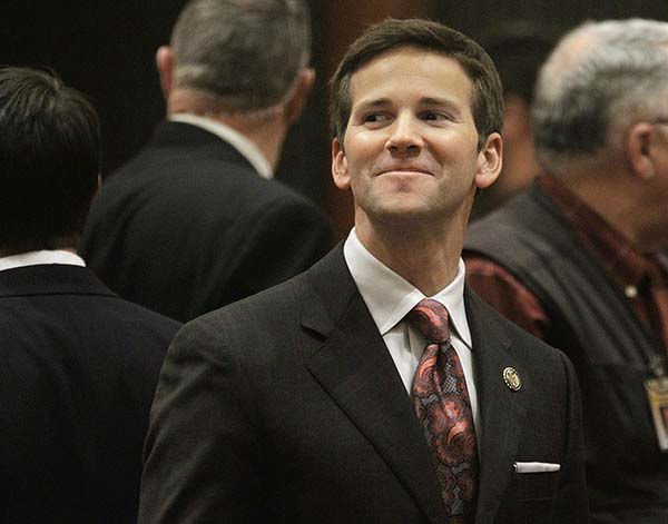 """<div class=""""meta image-caption""""><div class=""""origin-logo origin-image none""""><span>none</span></div><span class=""""caption-text"""">(FILE) U.S. Rep. Aaron Schock, R-Ill., who used to be an Illinois state representative, visits the House floor during session at the Illinois State Capitol in Springfield. (AP Photo/ Seth Perlman)</span></div>"""