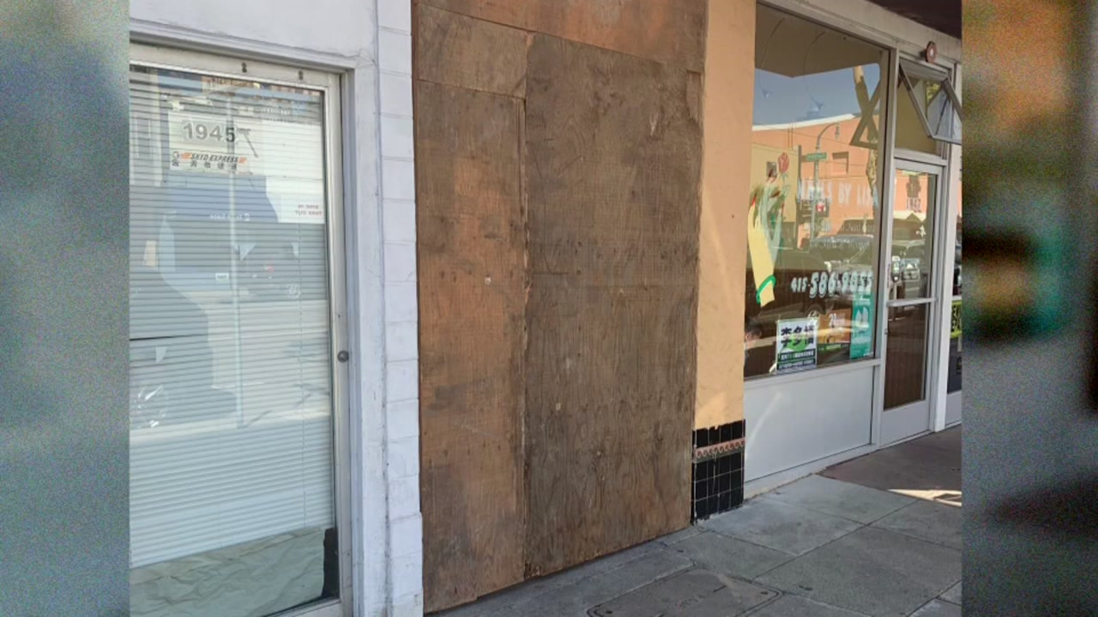 Neighbor blocks San Francisco alleyway with plywood wall to keep out homeless people, drug dealers