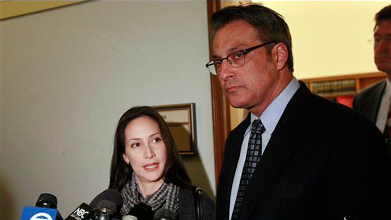 In this photo from Jan. 13, 2012, San Francisco Sheriff Ross Mirkarimi, right, and his wife Eliana Lopez speak to reporters at City Hall in San Francisco. (AP Photo/Jeff Chiu)