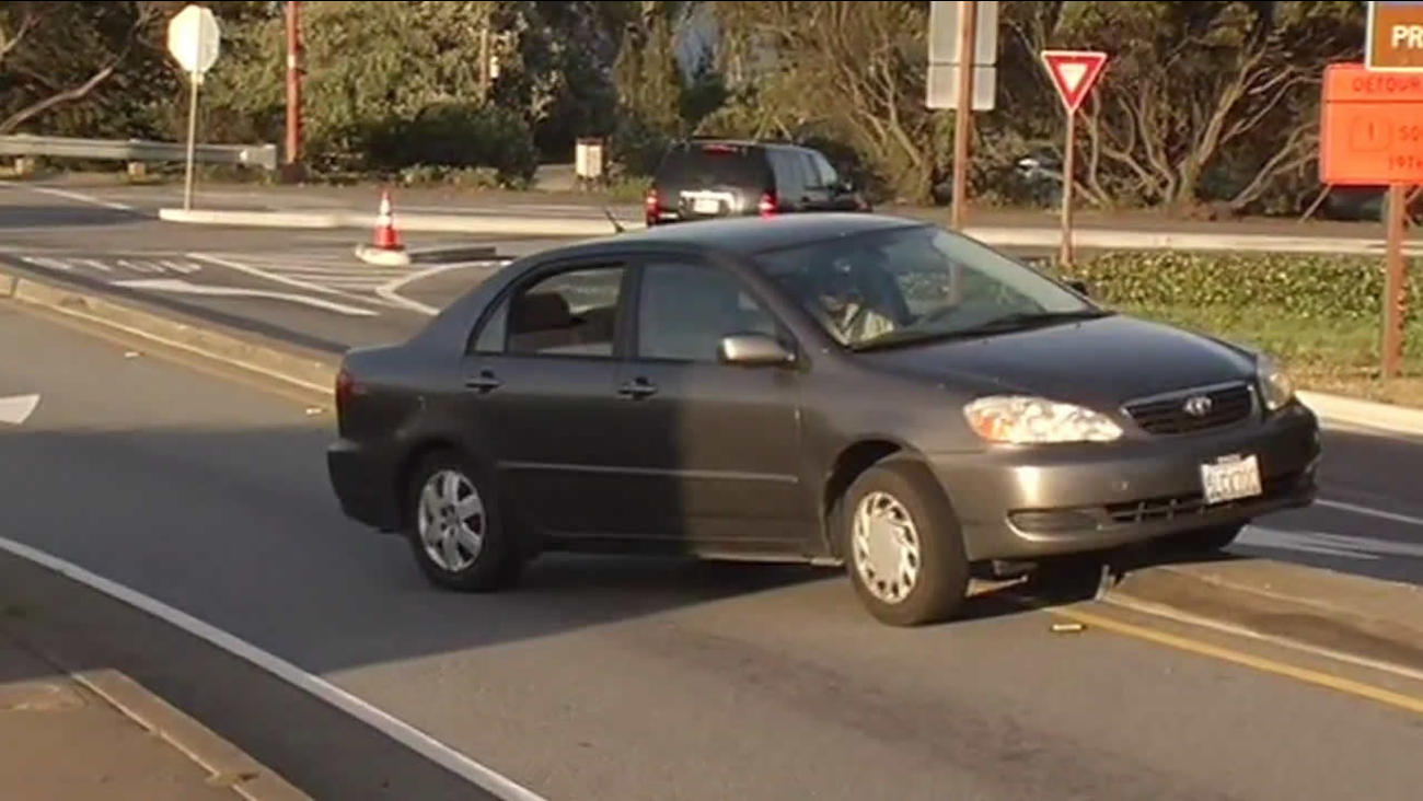 wrong way driver backs over curb near Golden Gate Bridge toll plaza