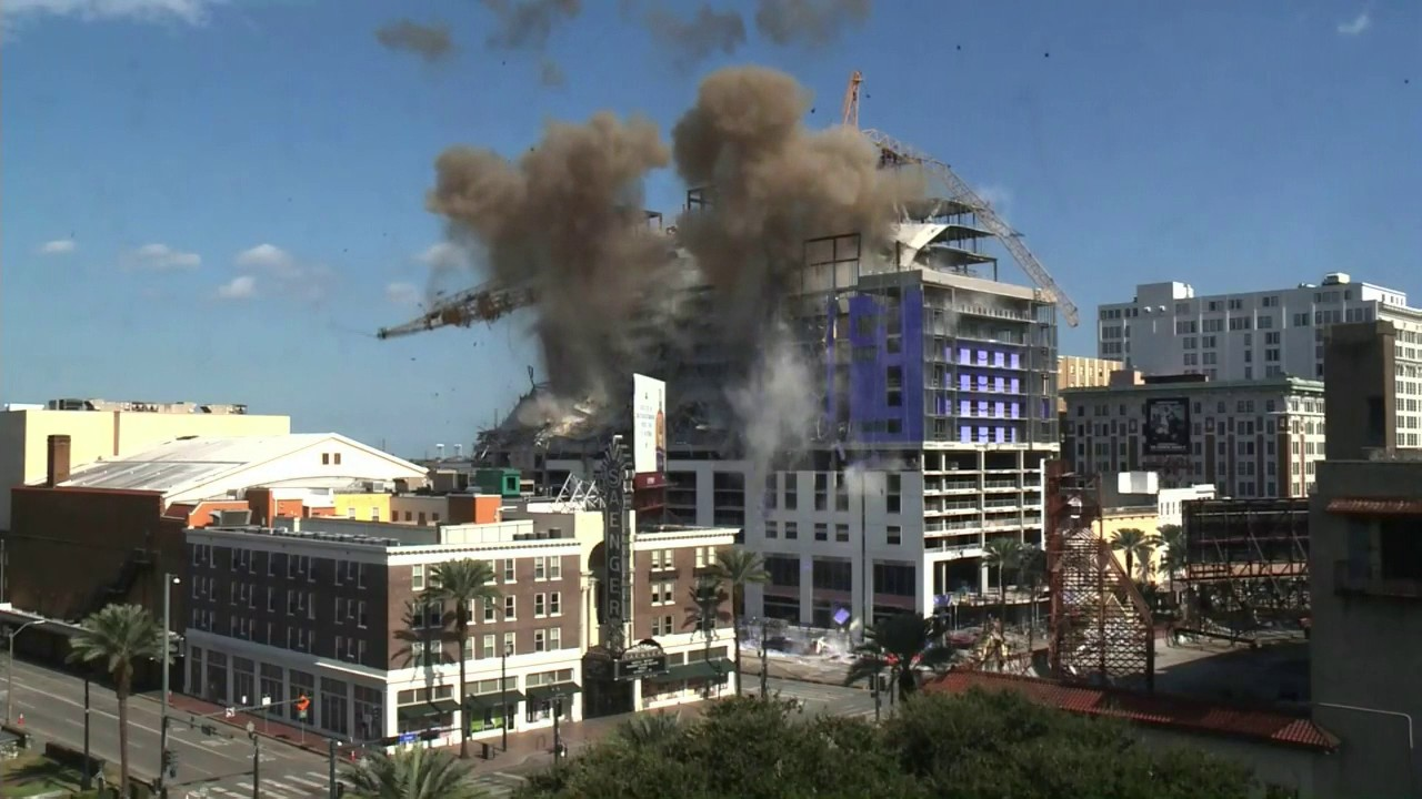 New Orleans sets off controlled explosions to demolish cranes at hotel site