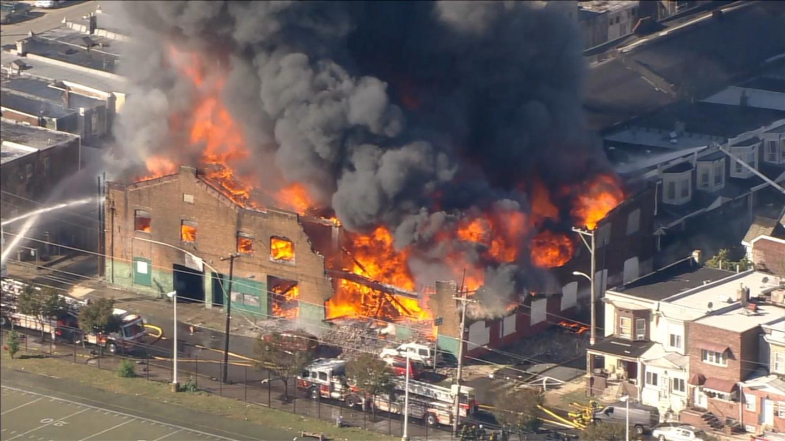 Philadelphia firefighters battling massive blaze at auto body shop in Cobbs Creek