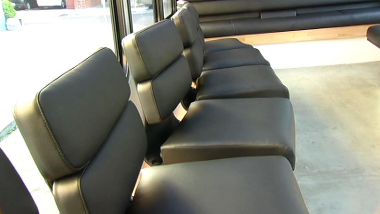 """<div class=""""meta image-caption""""><div class=""""origin-logo origin-image kgo""""><span>KGO</span></div><span class=""""caption-text"""">Leather seats inside the Leap bus. (KGO-TV)</span></div>"""