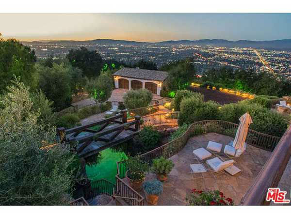 "<div class=""meta image-caption""><div class=""origin-logo origin-image none""><span>none</span></div><span class=""caption-text"">The Hollywood Hills West property includes a main house and guest house totaling 7 bedrooms on 2.5 acres. (Redfin.com/MLS)</span></div>"