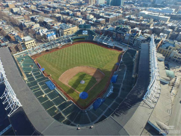 "<div class=""meta image-caption""><div class=""origin-logo origin-image none""><span>none</span></div><span class=""caption-text"">Chicago-based photographer Colin Hinkle got a birds-eye view over Wrigley Field this week to see how construction is coming along just a few weeks before opening day. (Colin Hinkle/Soaring Badger Productions)</span></div>"