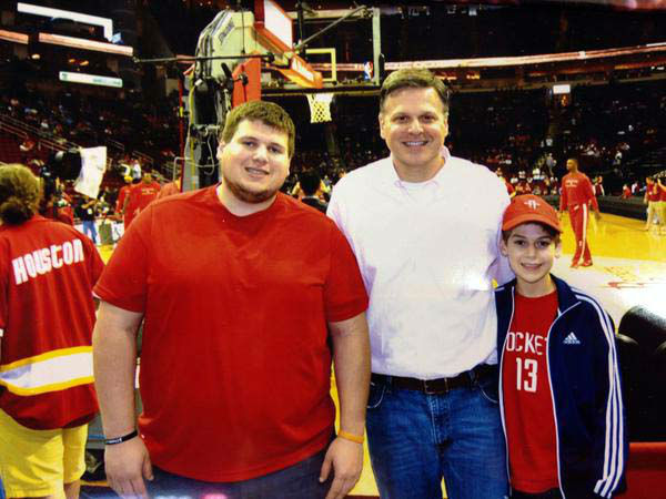 """<div class=""""meta image-caption""""><div class=""""origin-logo origin-image none""""><span>none</span></div><span class=""""caption-text"""">Tom Abrahams with his brother and son at the Rockets game</span></div>"""