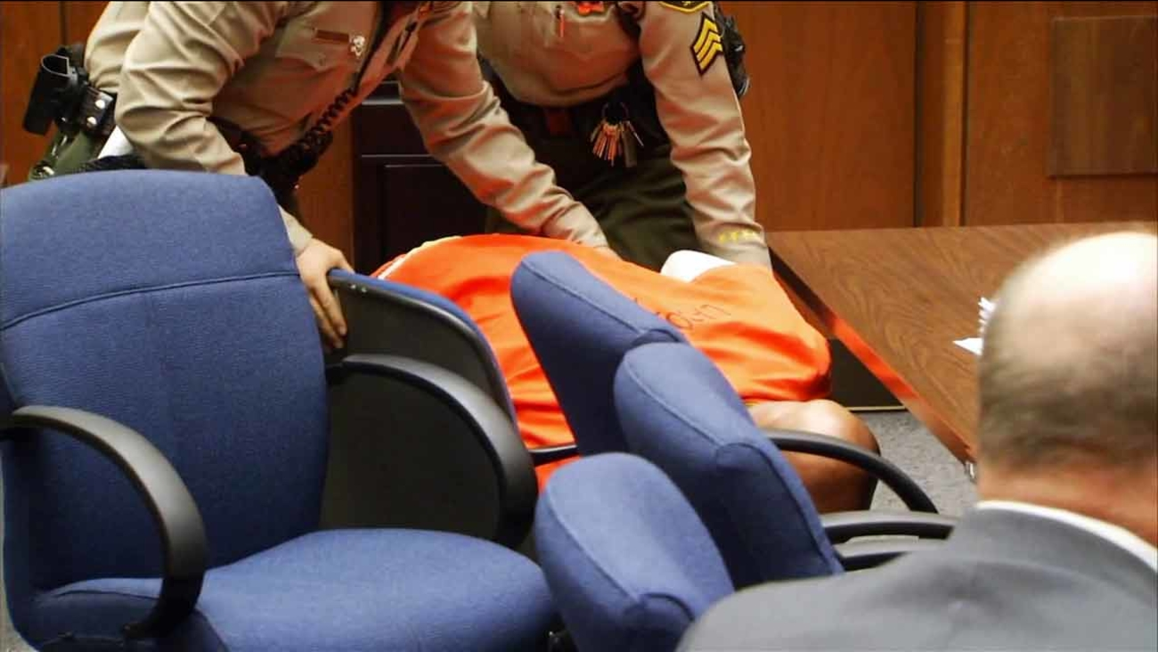 "Marion ""Suge"" Knight is shown slumped over in his chair in court after a judge set bail at $25 million on Friday, March 20, 2015."