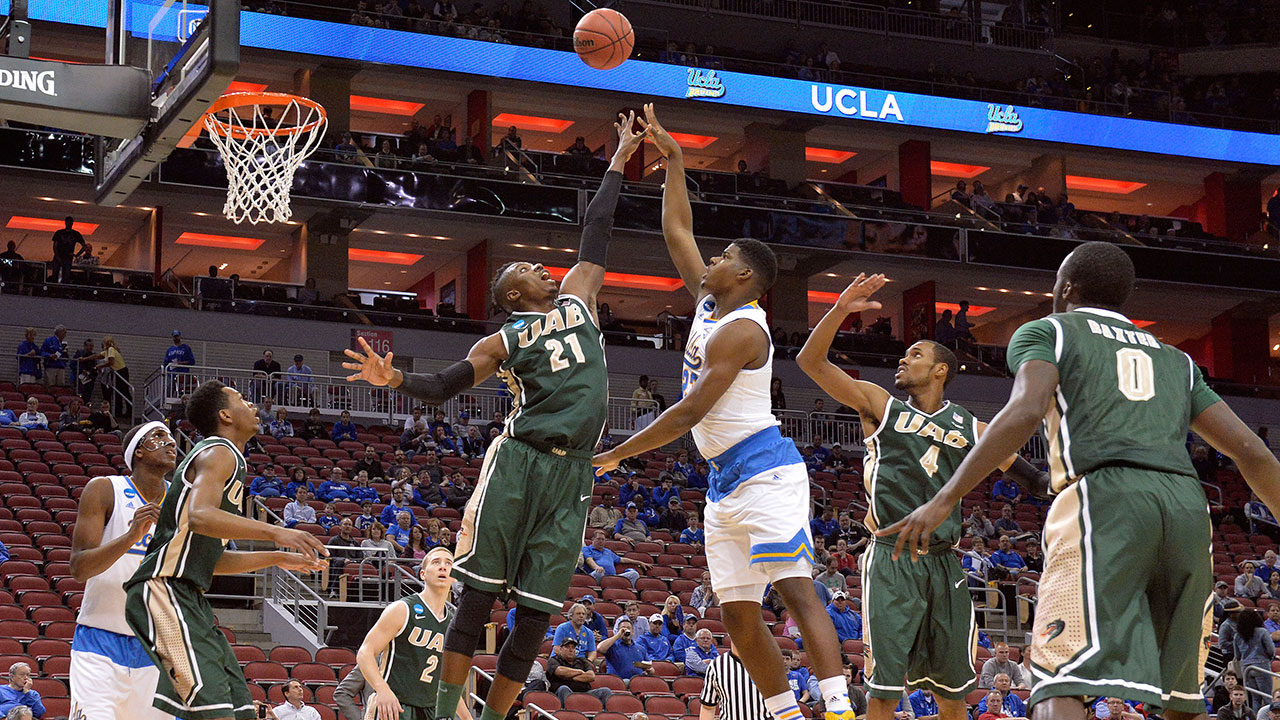 UAB's Tosin Mehinti (21) attempts to block the shot of UCLA's Tony Parker during the first half of an NCAA tournament college basketball game in Louisville, Ky., Saturday, March 21, 2015.