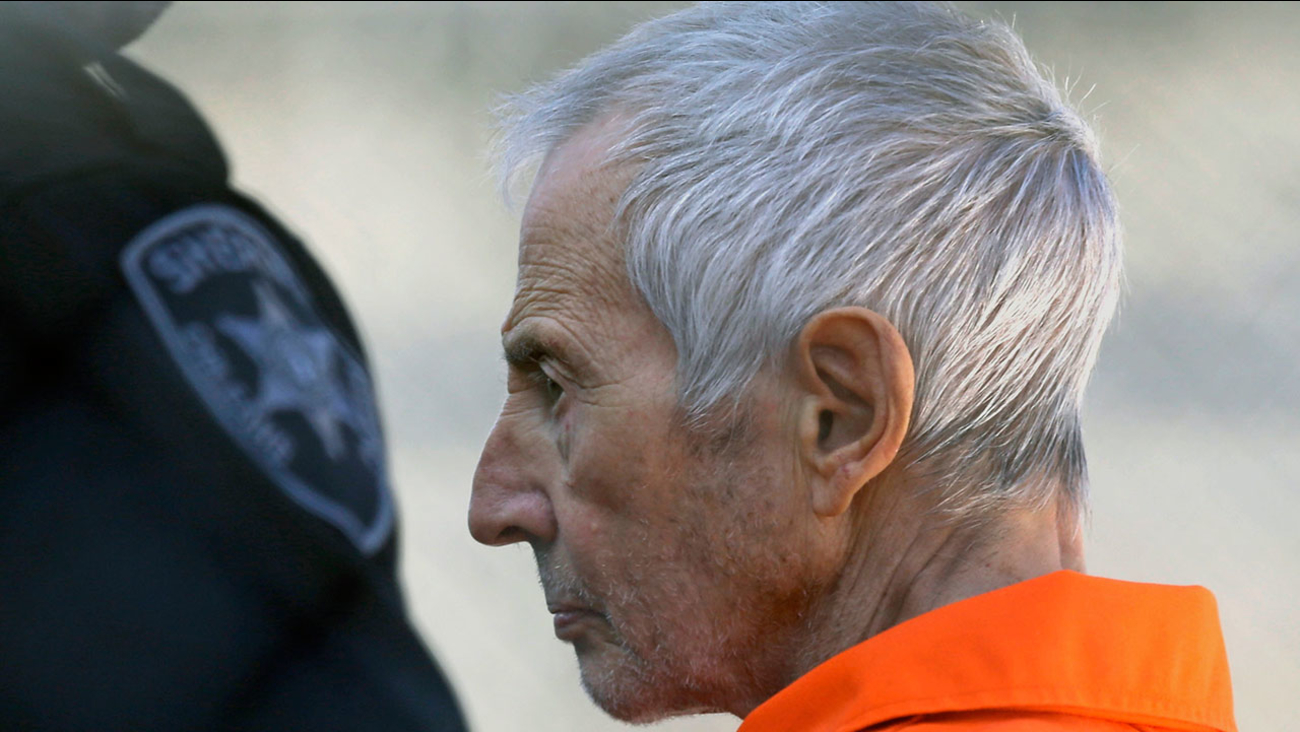 In this Tuesday, March 17, 2015, file photo, Robert Durst is escorted into Orleans Parish Prison after his arraignment in Orleans Parish Criminal District Court in New Orleans.