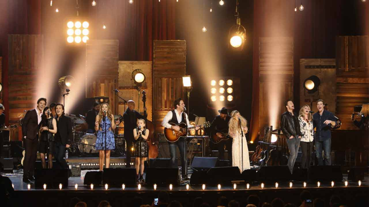 Sam Palladio, Aubrey Peeples, Jonathan Jackson, Lennon Stella, Maisy Stella, Charles Esten, Clare Bowen, Will Chase, Deana Carter and Chris Carmack are seen on stage.
