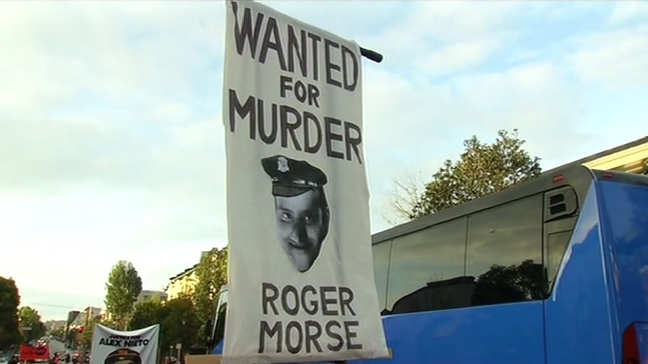 "<div class=""meta image-caption""><div class=""origin-logo origin-image kgo""><span>KGO</span></div><span class=""caption-text"">A poster of Officer Roger Morse, believed to be involved in the fatal shooting of Alex Nieto, held by protesters on Monday, March 23, 2015. (KGO-TV)</span></div>"