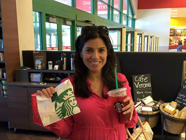 """<div class=""""meta image-caption""""><div class=""""origin-logo origin-image none""""><span>none</span></div><span class=""""caption-text"""">Patricia Lopez picking up her free pastry from Starbucks</span></div>"""