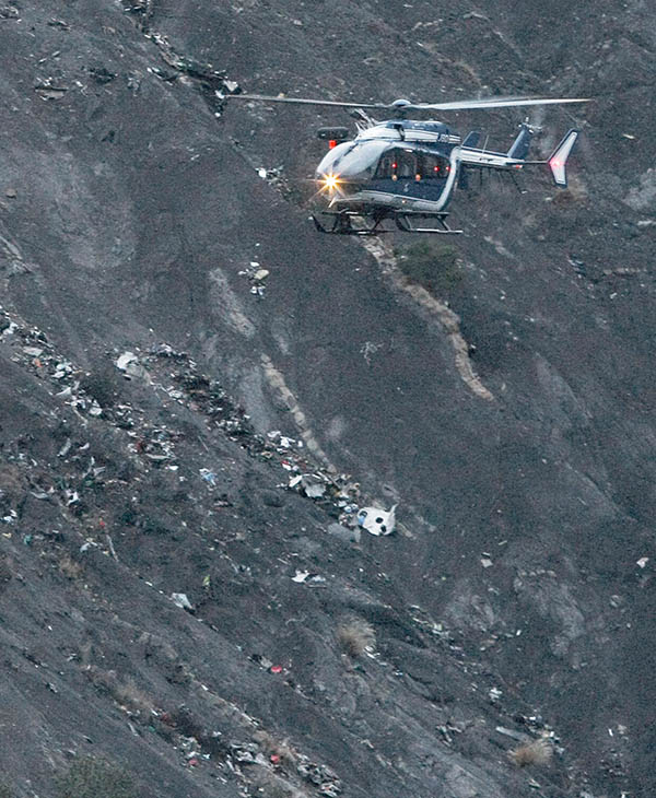 "<div class=""meta image-caption""><div class=""origin-logo origin-image ap""><span>AP</span></div><span class=""caption-text"">A recue helicopter flies over debris of the Germanwings passenger jet, scattered on the mountain side, near Seyne les Alpes, French Alps, Tuesday, March 24, 2015.</span></div>"