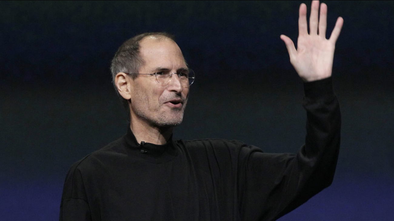 Chairman and CEO Steve Jobs waves to his audience at an Apple event at the Yerba Buena Center for the Arts Theater in San Francisco. (AP Photo/Jeff Chiu)