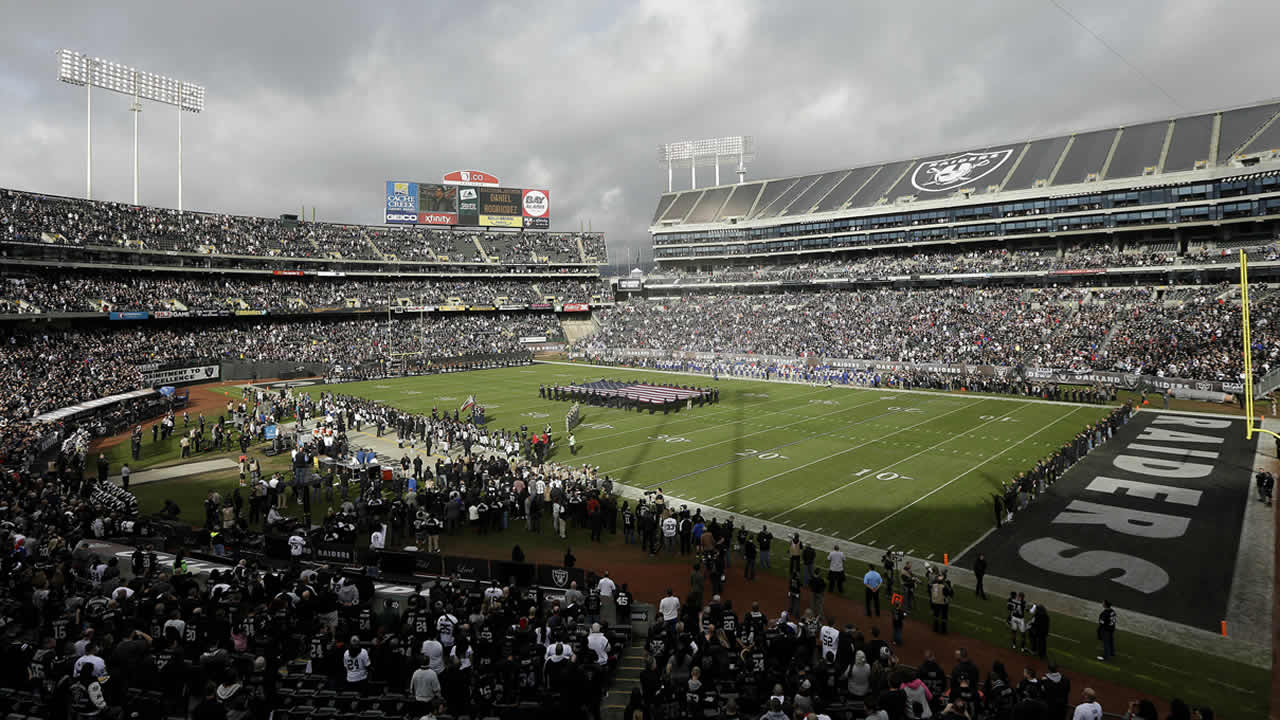 Fans watch from a view at the Coliseum in Oakland, during the first quarter of an NFL football game between the Oakland Raiders and the Buffalo Bills on Dec. 21, 2014 (AP Photo/Marcio Jose Sanchez, File)
