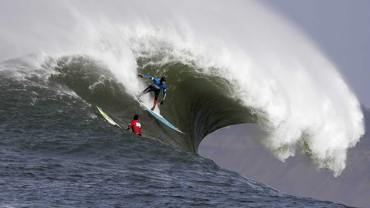 Peter Mel catches a wave during the second heat of the first round of the Mavericks Invitational big wave surf contest Friday, Jan. 24, 2014, in Half Moon Bay.