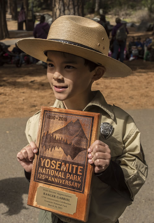 Honorary Yosemite National Park Ranger Gabriel Lavan-Ying poses with a plaque that was presented to him in Yosemite National Park, Calif. on March 24, 2015.