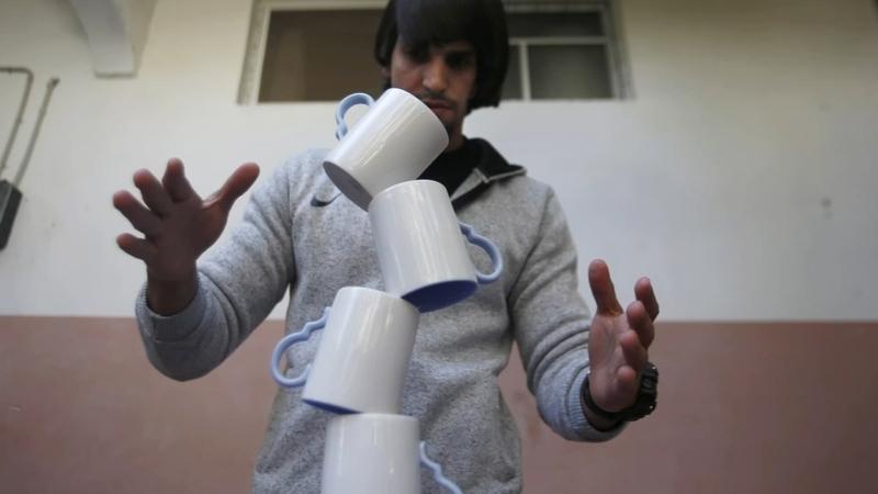 Gaza Man Masters Rare Skill Of Balancing Art Abc7 Chicago