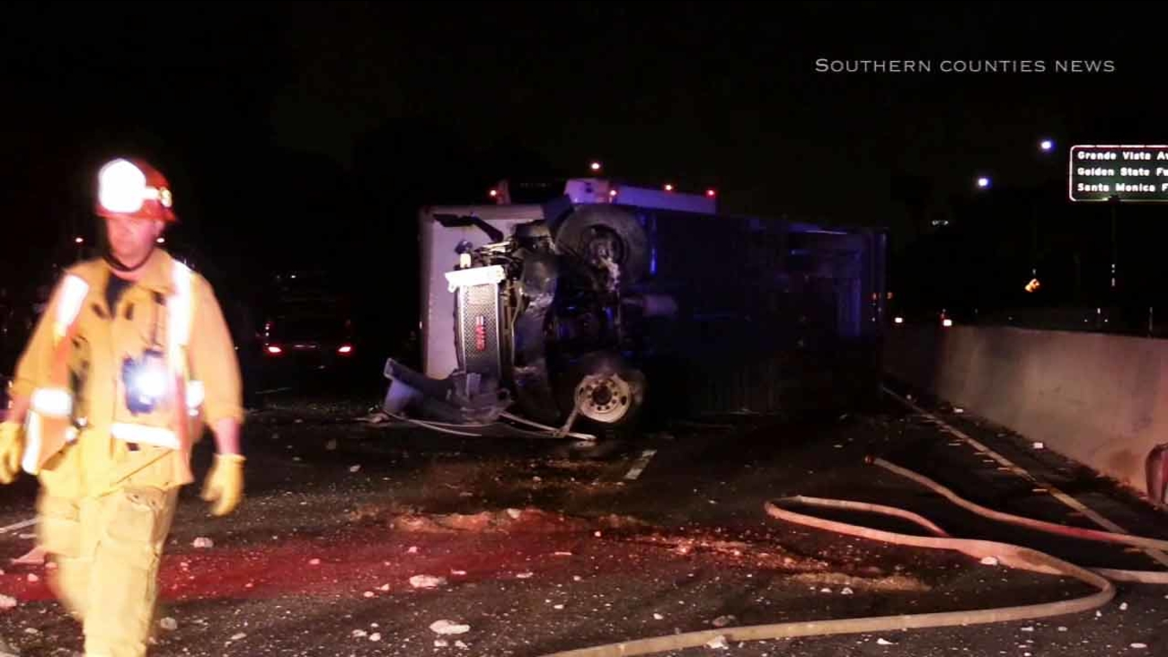 An overturned big rig closed all southbound lanes of the 5 Freeway near Indiana Street in East Los Angeles on Wednesday, March 25, 2015.