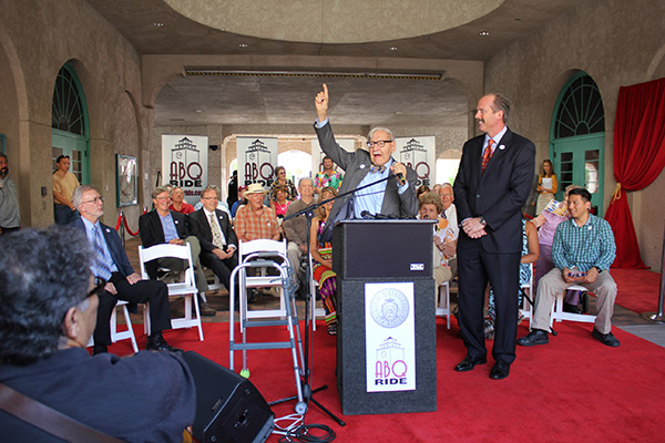 """<div class=""""meta image-caption""""><div class=""""origin-logo origin-image none""""><span>none</span></div><span class=""""caption-text"""">Dr. George receives the first plaque on the Wall of Fame at the Alvarado Transportation Center in Albuquerque, New Mexico, on July 8, 2013. (ABQ RIDE)</span></div>"""