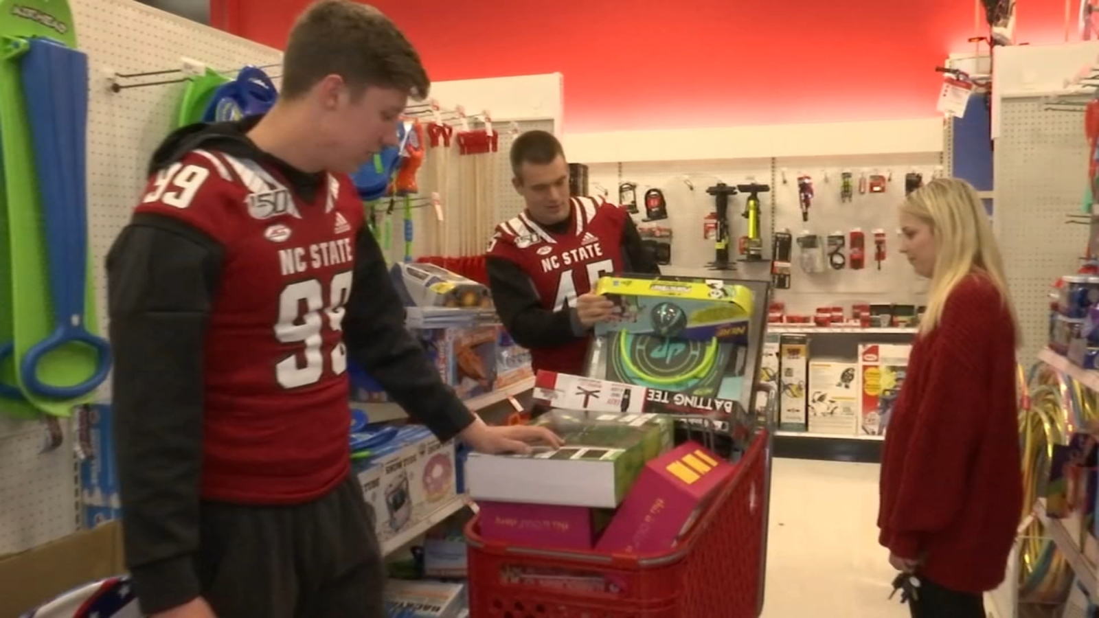 NC State football players go shopping for annual Toys for Tots holiday event