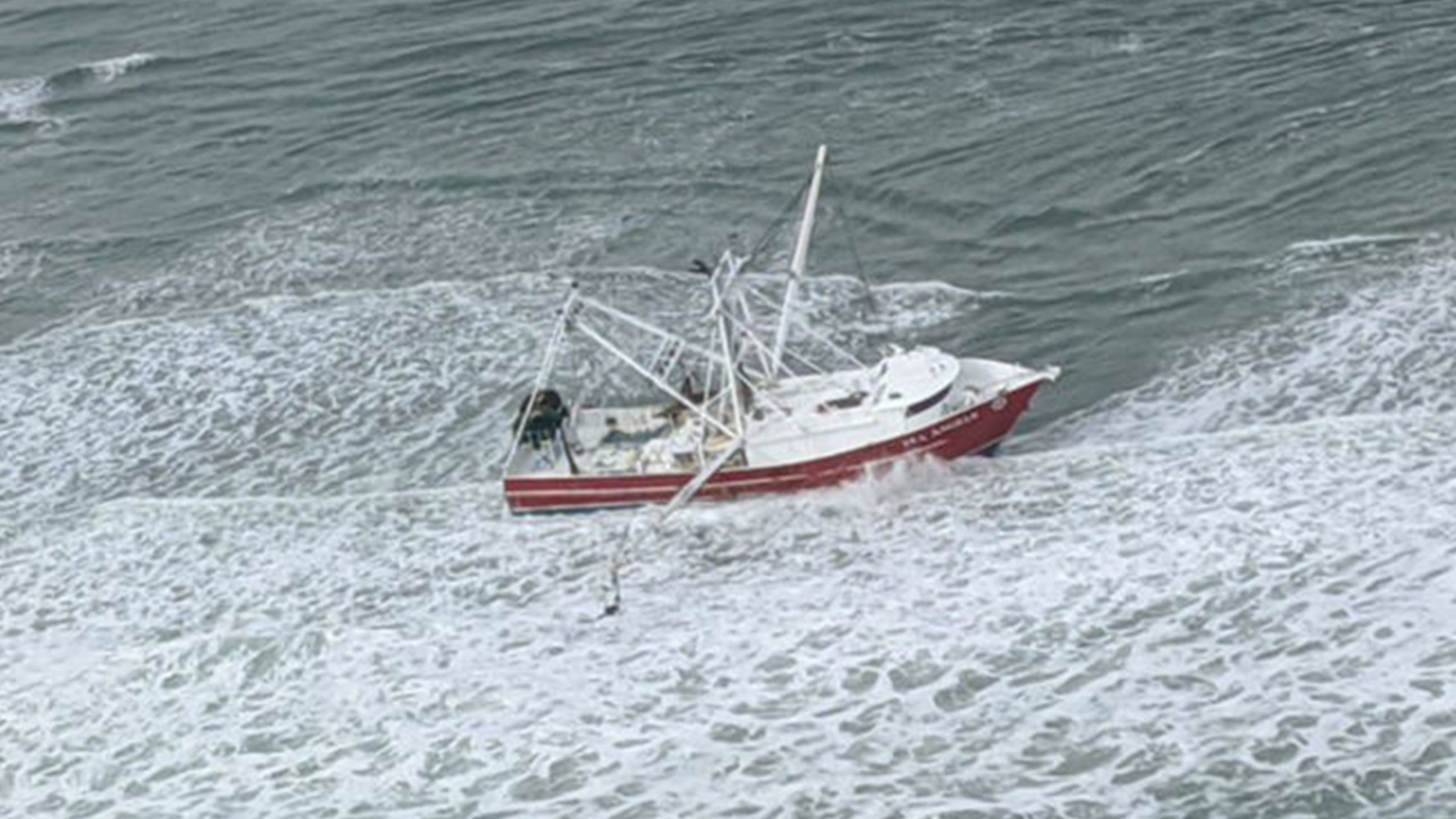 Boat with 15,000 gallons of fuel runs aground near area that could have WWII ordinance