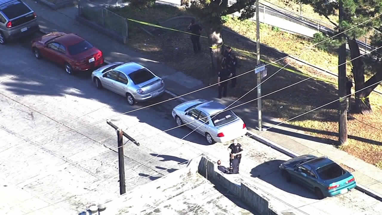 Police investigate a shooting in San Francisco on March 26, 2016.