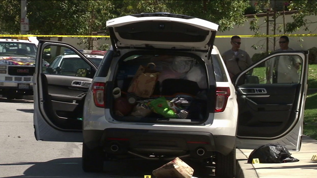 A white minivan, owned by a 42-year-old San Dimas woman suspected of murdering her mother-in-law, is being investigated by police on Wednesday, March 25, 2015.