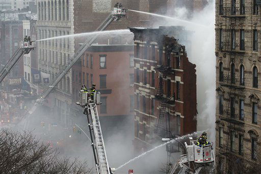 "<div class=""meta image-caption""><div class=""origin-logo origin-image none""><span>none</span></div><span class=""caption-text"">New York City firefighters work the scene of a large fire and a partial building collapse in the East Village neighborhood of New York on Thursday, March 26, 2015. (AP Photo/ John Minchillo)</span></div>"