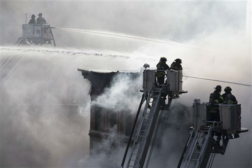 "<div class=""meta image-caption""><div class=""origin-logo origin-image none""><span>none</span></div><span class=""caption-text"">Firefighters spray water on a collapsed building in New York's East Village, Thursday, March 26, 2015, in New York. (AP Photo/ John Minchillo)</span></div>"