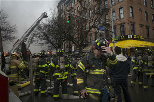 "<div class=""meta image-caption""><div class=""origin-logo origin-image none""><span>none</span></div><span class=""caption-text"">New York City firefighters work the scene of a large fire and a partial building collapse in the East Village neighborhood of New York on Thursday. (AP Photo/ John Minchillo)</span></div>"