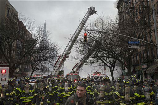 "<div class=""meta image-caption""><div class=""origin-logo origin-image none""><span>none</span></div><span class=""caption-text"">New York City firefighters work the scene of a large fire and a partial building collapse in the East Village neighborhood of New York. (AP Photo/ John Minchillo)</span></div>"
