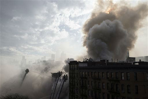 "<div class=""meta image-caption""><div class=""origin-logo origin-image none""><span>none</span></div><span class=""caption-text"">New York City firefighters work the scene of a large fire and a partial building collapse in the East Village. (AP Photo/ John Minchillo)</span></div>"