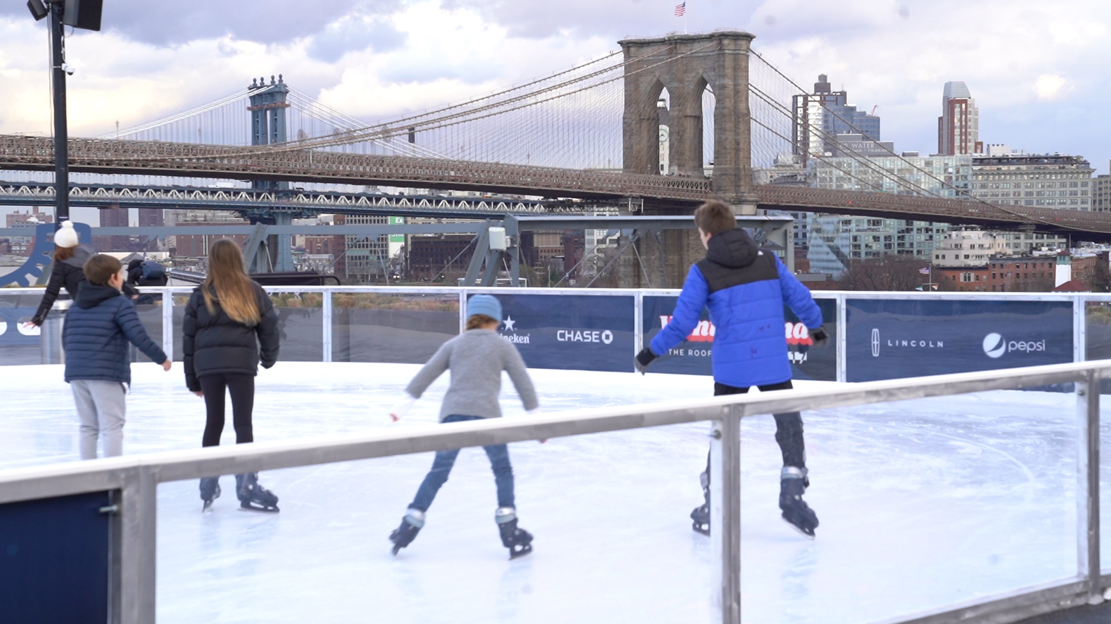 Ice skate on rooftop in Manhattan with skyline views of New York City