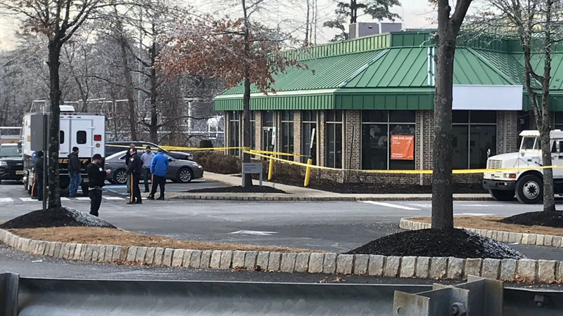 Image result for Guard shoots man who tried to grab cash bag at New Jersey bank