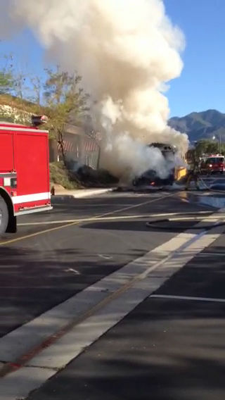 """<div class=""""meta image-caption""""><div class=""""origin-logo origin-image none""""><span>none</span></div><span class=""""caption-text"""">A school bus fire in Rancho Santa Margarita was caught on camera on Friday, March 27, 2015.</span></div>"""